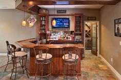 Basement bar complete with a wine cellar [Design: Build Cincinnati of Coldwell Banker]