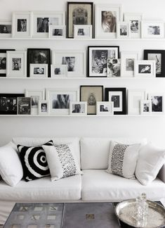 Photo Gallery Wall from Annika von Holdt {shelves from Ikea painted flat white}