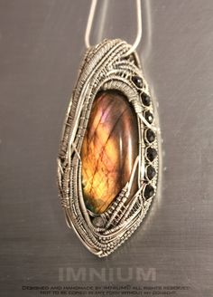 Golden labradorite pendant - large statement piece - biomechanic sterling silver wrap