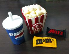 "This listing is for the full scale paper pattern and easy to follow detailed step-by-step photo instructions for making your very own felt movie set including:  - Popcorn & Popcorn Box - Cup of Cola - Chocolate Bars - Chocolate Candies  Popcorn box measures appx 4.5""(Height) Candy bars me..."