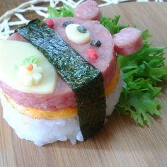 Kawaii food art and cute snacks. Bear spam sushi