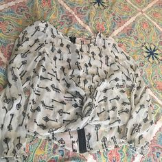 Forever 21 key print blouse I absolutely love this blouse. It has such a feminine style and the keys add a cute touch. A little added padding on the shoulders, so girly! It unfortunately does not fit me too well since I have a long torso it fits short. Forever 21 Tops Blouses