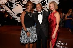 "Our soror Erika Liles on the right, wearing an ""angry pink"" dress. With husband Kevin and another lady."