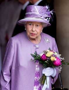 Queen Elizabeth II, 91, was picture perfect for a summer evening in a lilac floral dress with a matching coat and hat as she arrived at th...
