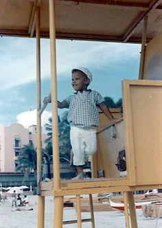 Barack Obama on Waikiki beach before his mother married Lolo Soetoro and moved with Barack and her new husband to Indonesia. Here, he's in a lifeguard standing next to the famous pink Waikiki hotel, The Royal Hawaiian.