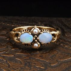 Opal and Pearl 9K Yellow Gold Vintage Ring. I would want a wedding ring like this. So different and unique from other rings.