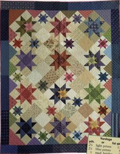 love quilts with two sizes of similar blocks, not wild about these colors but they are ok. cookies 'n' quilts by judy martin