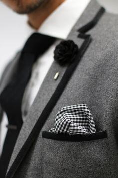 Mens Fashion - Grey blazer with black trim, white shirt, black tie, gingham pocket square, black tie clip, black lapel flower