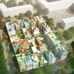 MVRDV wins a competition to design housing in Emmen, Switzerland comprising pastel-coloured houses and apartment buildings with courtyards and gardens.