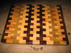 3 dimensional end grain cutting board highlights the for Puzzle cutting board plans