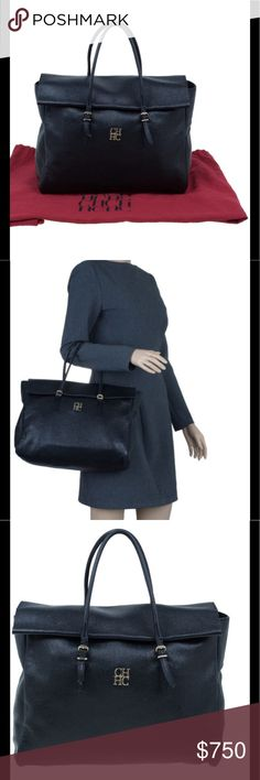 AUTHENTIC Carolina Herrera Handbag Navy Blue Authentic Carolina Herrera Navy Blue Leather handbag will be on SALE. This piece is a unique Pre-Loved Fashion Designer handbag with signs of wear such as scratches, stains, among others . I have posted pictures of actual condition of this item. Handbag comes with dust bag. Carolina Herrera Bags Totes
