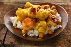 Curried Cauliflower, Chickpeas, and Tofu  Looks Really good. This is a must try... of course I will substitute chicken for the tofu or add more cauliflower