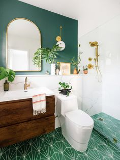 Dabito of Old Brand New reveals his modern bohemian bathroom inspired by an acacia plant in his backyard. Featuring green, patterned cement tile and Champagne Bronze faucets and showering fixtures from Delta.