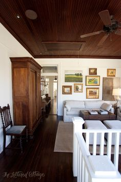 Love the wood ceiling & how the color matches that floor ~ makes the room feel cozy & it looks great with the white walls ~ from The Lettered Cottage ~ Southern Style House Tour (Part)