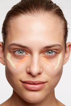 """Step 2: Create a """"Hollywood V"""": yellow-tone concealer on cheekbones and a peachy one below each eye. Blend together."""