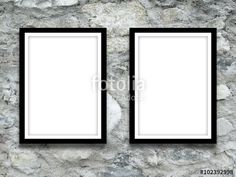 Close-up of two black picture frames on grey stone wall background