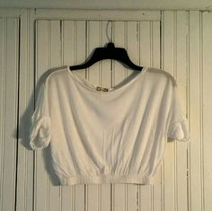 White Crop Top White crop top with elastic waistband and folded short sleeves. Pretty sheer but looks really cool with a bright swimsuit or tank top underneath Tops Crop Tops
