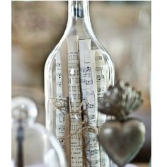 cedar hill farmhouse instagram photo - Rolled up sheet music in a glass bottle #interiordecorating #vintagestyle #musical https://instagram.com/p/0_Qk-_nU4d/ via bHome https://bhome.us