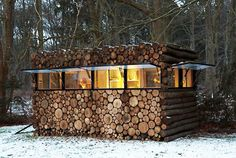 From the back, this camouflaged log cabin in the Netherlands appears to be a stack of log rounds. The front reveals a modern music studio and office, designed by Piet Hein Eek. The windows allow the owner to conceal the cabin completely, crafted from a wood facade (like the rest of the cabin). Did we mention it also has wheels?