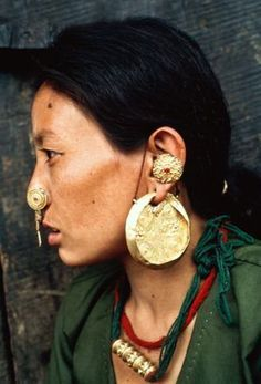 Sikkim Woman wearing her gold jewellery in Yaksam