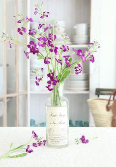 Violet flowers in the bottle. French chic