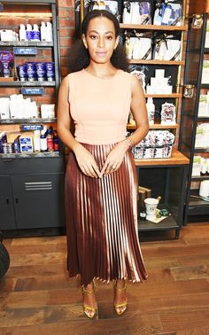 Solange Knowles wears a nude and metallic midi dress with ankle-strap heels