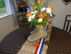 Flowers in boots and DIY table runner. Could be used to adverts Operation Thin Mint for cookie sale season Military Retirement Parties, Military Party, Retirement Celebration, Army Party, Military Mom, Military Gifts, Military Veterans, Army Mom, Retirement Ideas