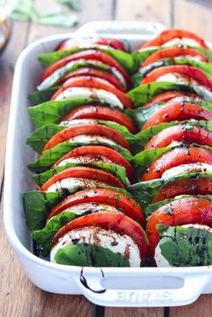 Light and easy appetizer or salad, loaded with tomatoes, fresh mozzarella, basil and balsamic reduction