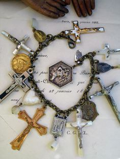 Rosary Cross Repurposed Bracelet with St. Christopher Medal use a lot of rosaries in my