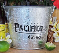 Pacifico Clara Galvanized Beer Bucket Pacifico https://www.amazon.com/dp/B002L20N0C/ref=cm_sw_r_pi_dp_x_Z573ybS9P11TE