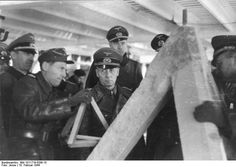 Field Marshal Erwin Rommel inspecting the Atlantic Wall at Lorient, France, 19 Feb 1944.
