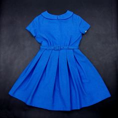 Extraordinary find!Wonderful 50's girl's ensemble, new with tag and in perfect condition!Little jacket is fully lined with a soft blue/ grey fabric. Large collar, two tiny pockets in the front; Also lined.Jacket comes with sewed in spare fabric and button.Dress with lovely collar, little belt at the waistline, flat pleats on the skirt.Fastens with 4 fabric covered buttons up the back.You can feel the love and attention they've put in the fabrication of this dress a...