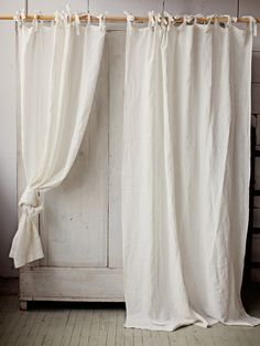Soft natural texture, romantic ties, easy draping - this curtain is perfect finish of a modern, scandinavian or classic decor. Curtains create privacy while allowing in just enough filtered light to keep a room cheerful.  - The listing is for 1 curtain panel - Can be made with a pole pocket instead of ties under special request (same price). - 7 colours available. - Composition: 100% linen, softened with natural stonewashing. Sizes:  Width: 53 (135 cm) or 93 (236 cm)  Height (not including…