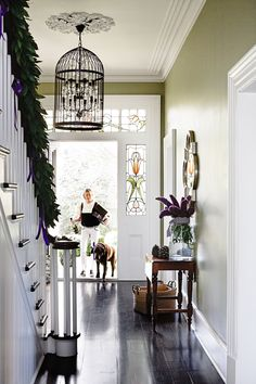 A mahogany staircase is one of the home's standout original features. The floorboards have been refinished in a blend of wenge and black japan stains. Our inspiration for the hallway colour came from the leadlight windows, says Jo. Elegant Christmas Decor, Elegant Home Decor, Elegant Homes, Edwardian Staircase, Edwardian House, Victorian Gothic, Edwardian Hallway, Victorian Homes, Black Floorboards
