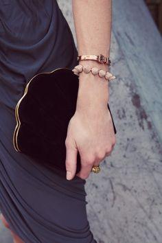 Hilary Rhoda wearing Alexander Wang Dress, Charlotte Olympia Bag, Jennifer Fisher Ring, Eddie Borgo Cone Bracelet, and Michael Kors Buckle Bracelet.  via Refinery 29 photo shoot.