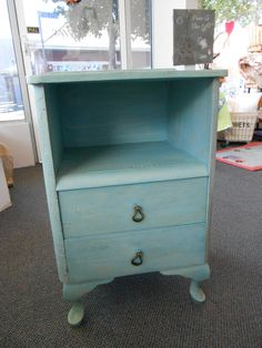 Little cupboard done in layers of Greek Blue, Provence and Duck Egg Chalk Paint™ by Annie Sloan, both clear and dark wax, original handles approx 90 years old, it now lives again
