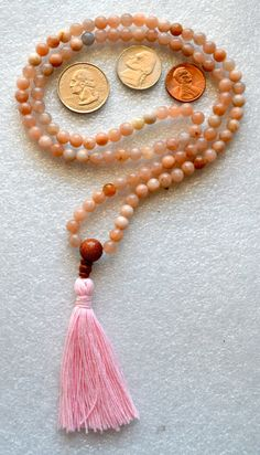 A personal favorite from my Etsy shop https://www.etsy.com/listing/212350279/moonstone-natural-flower-handmade-mala
