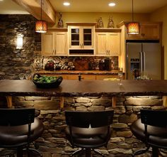 15 Rustic Kitchen Design Photos. Lights in the island, rock and wood.