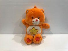 LAUGH A LOT BEAR, orange care bear, talking care bear, bear with star on stomach #CareBears
