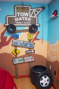 Radiator Springs, I have a three year old who is infatuated with Lightning McQueen and the world of Cars, so when we moved to a new home, I took the opportunity to create a little slice of Radiator Springs for him to live in., The Tow Mater sign is home-made. The hooks along the top support are used for hats, jackets, etc. The plastic tire bins are used for laundry or toys. , Boys Rooms Design