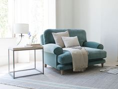 Slowcoach love seat in our Sea Blue vintage velvet - bay window armchair shutters