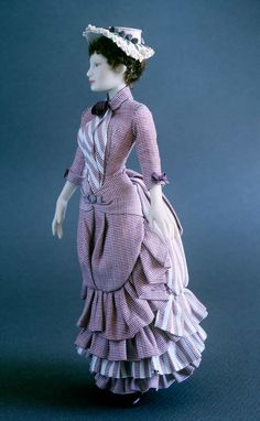 NAME: Marguerite - PERIOD: 1883-1885. Walking suit in printed cotton with bustle. Hat trimmed with embroideries and roses.
