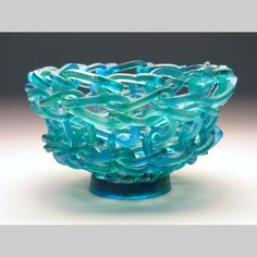 Of all things, knitted glass. Yes, really knitted and really glass! ~ Baskets & Bowls - Rumba Kiln-Cast lead crystal knitted glass