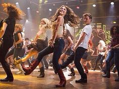 *Take the boots of their pedestal and dance at a country bar