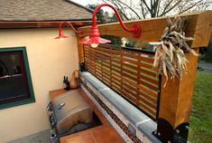 Good idea for outdoor kitchen lighting.    Goosenecks and Post Mount Lights for a California-Style Patio | Barn Light Electric Blog