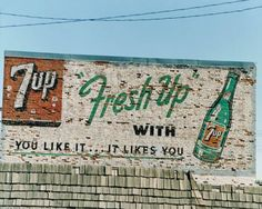 A fine art photograph of a 7-UP wall advertisement.