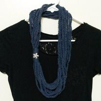 Accessorize with this stylish scarf!  Also called a cowl, this handmade item will compliment any outfit.  Yarn is denim-colored with multi-colored flecks.  Handmade out of acrylic yarn.  Ready to ship.