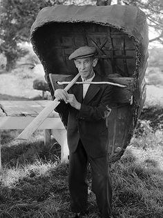Man with his coracle on the banks of the Teifi, near Cardigan, 1 June 1952