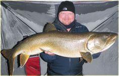Huge lake trout caught while ice fishing at Scott Lake Lodge