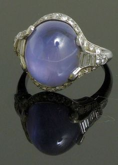 I inherited a ring similar to this when my Great Grandmother passed away. The stone is a star sapphire.